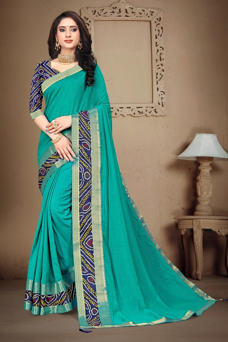 Art Silk Fabric Daily Wear Fancy Cyan Color Printed Lace Work Saree