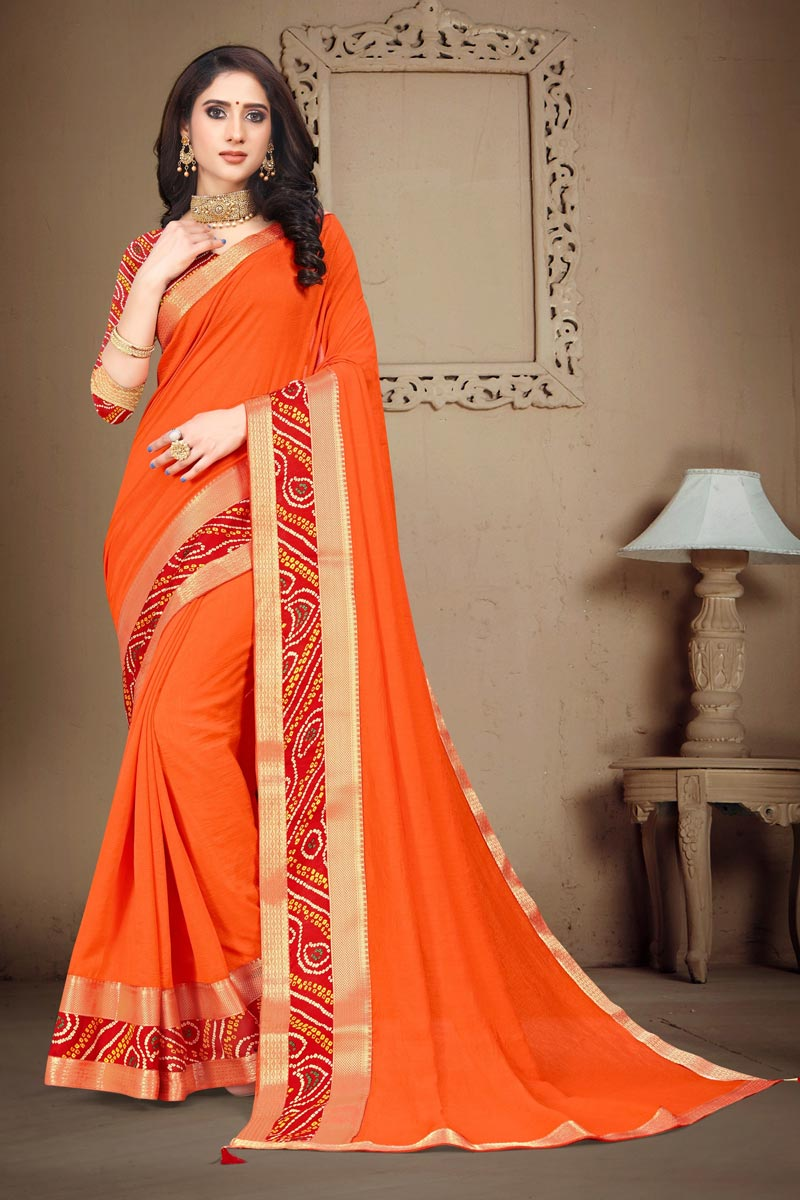 Orange Color Fancy Daily Wear Art Silk Fabric Printed Lace Work Saree