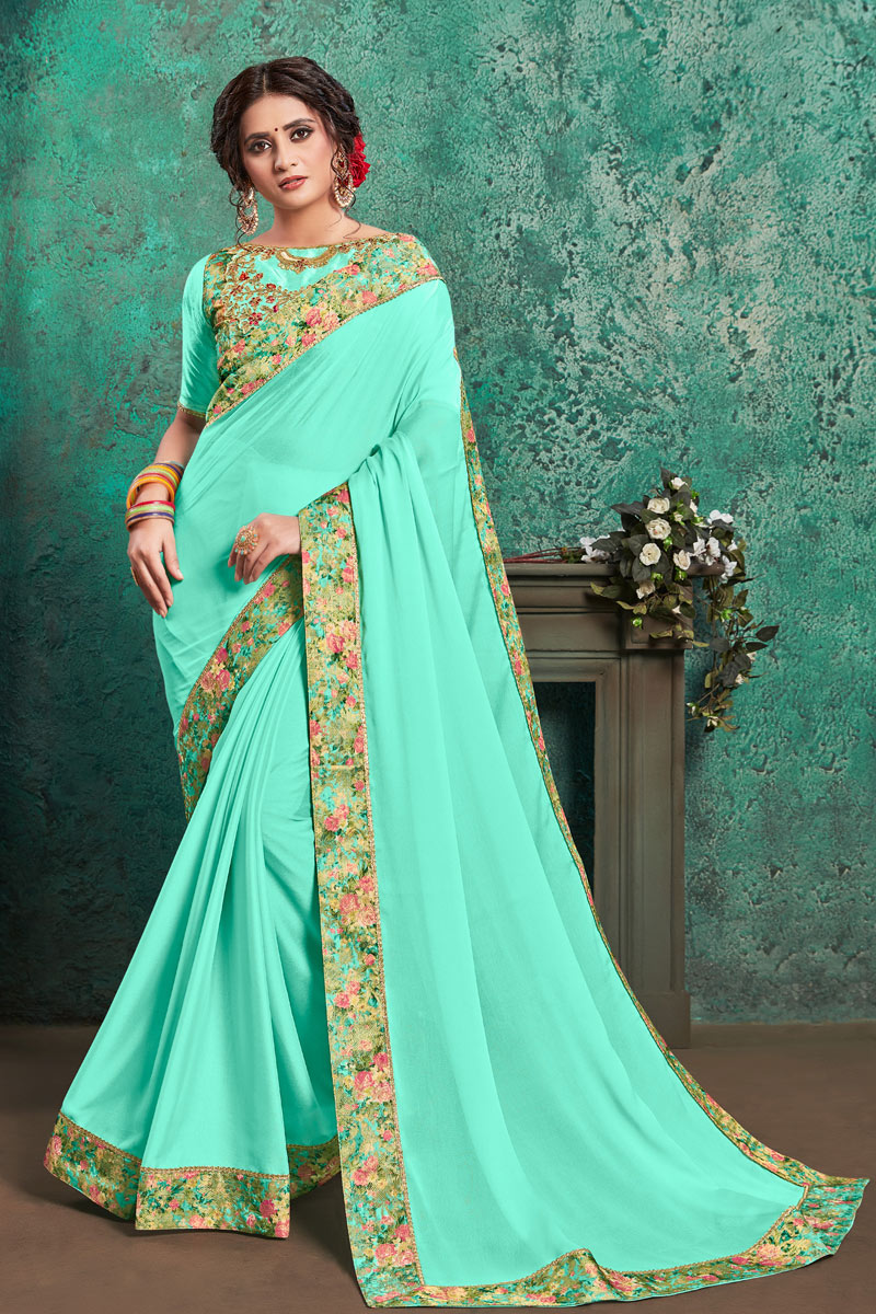 Border Work On Cyan Color Georgette Fabric Party Wear Saree With Amazing Blouse