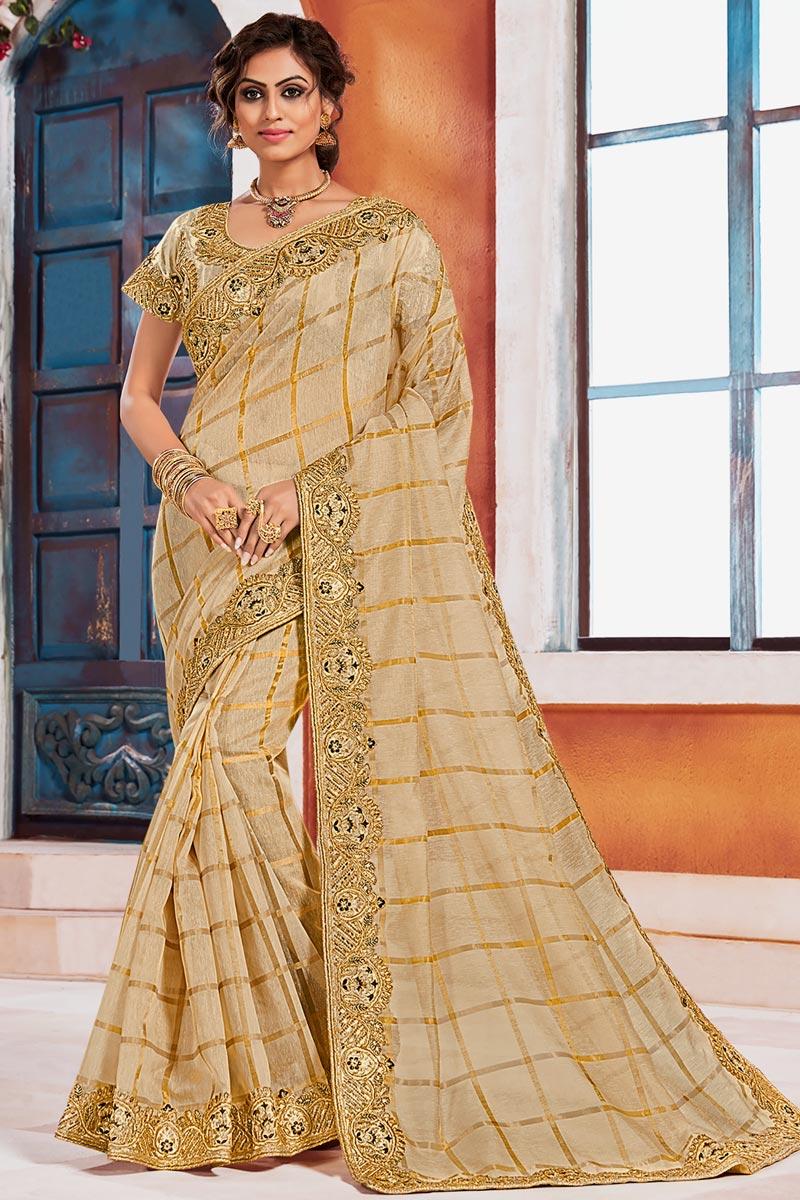 Art Silk Fabric Elegant Puja Wear Beige Color Embroidered Border Work Saree