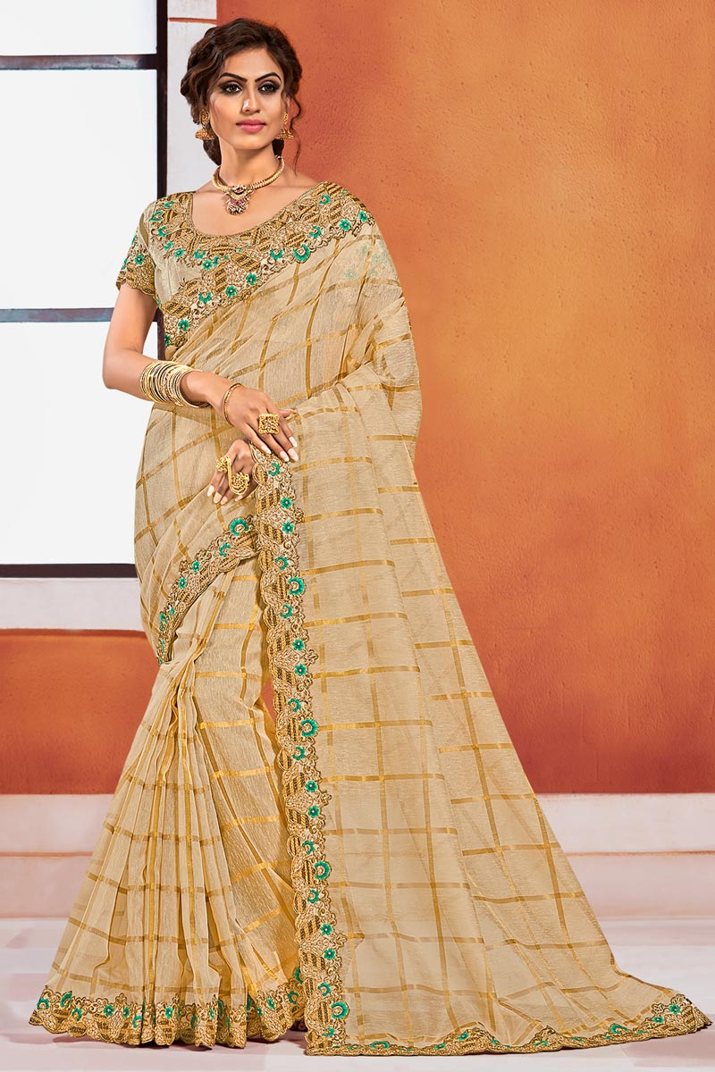 Puja Wear Elegant Beige Color Embroidered Border Work Saree In Art Silk Fabric