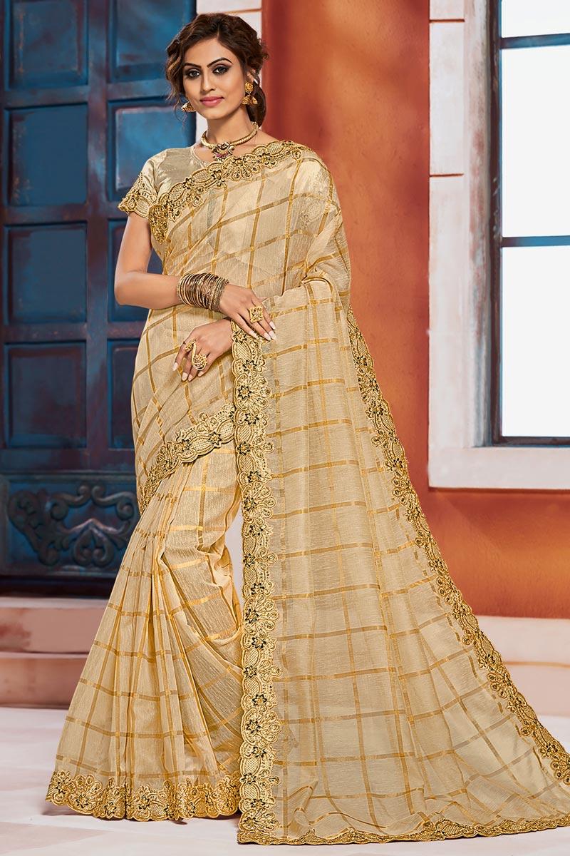 Puja Wear Beige Color Elegant Embroidered Border Work Saree In Art Silk Fabric