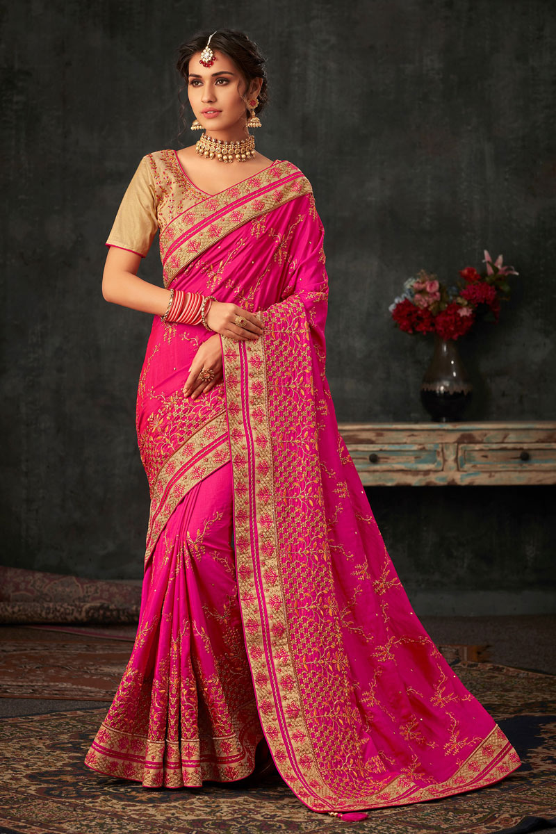 Art Silk Fabric Rani Color Occasion Wear Saree With Embroidery Work And Designer Blouse