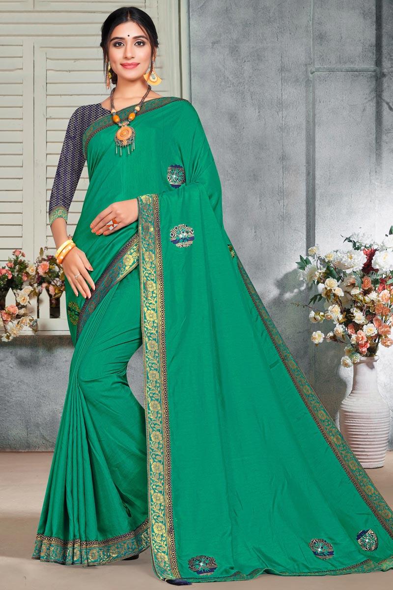 Puja Wear Elegant Green Color Lace Work Saree In Art Silk Fabric