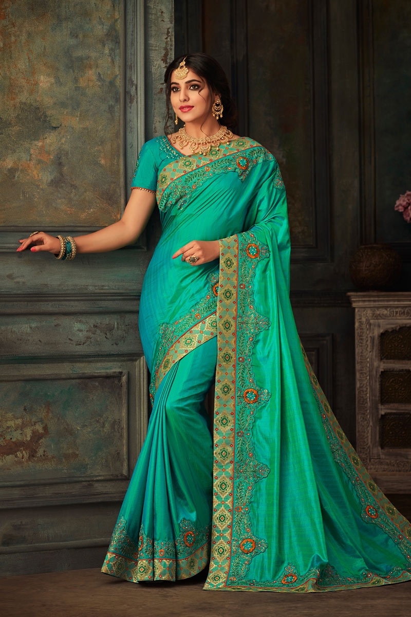 Light Turquoise Color Art Silk Fabric Wedding Wear Saree With Embroidery Work And Gorgeous Blouse