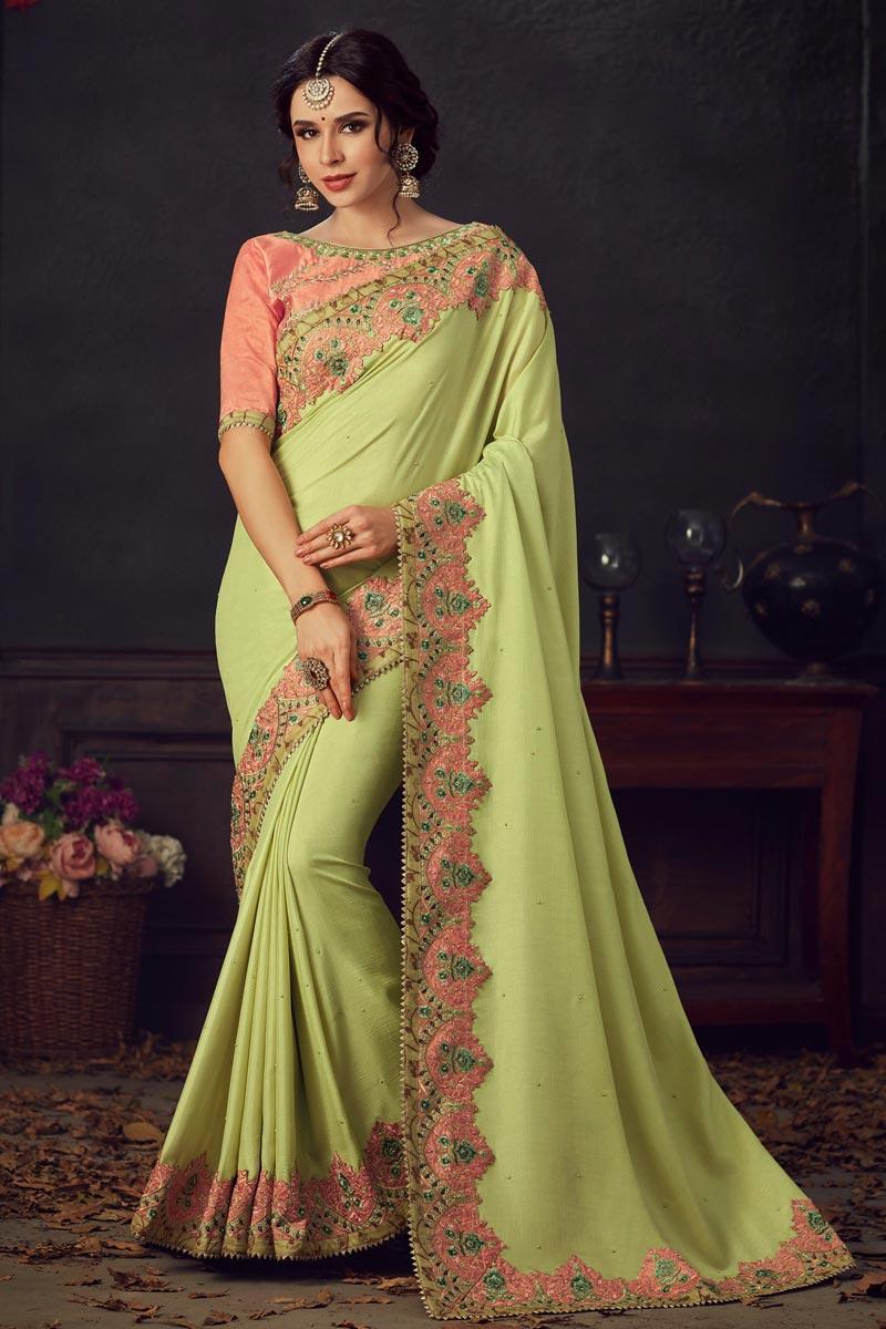 Art Silk Fabric Fancy Traditional Wear Sea Green Thread Embroidered Saree