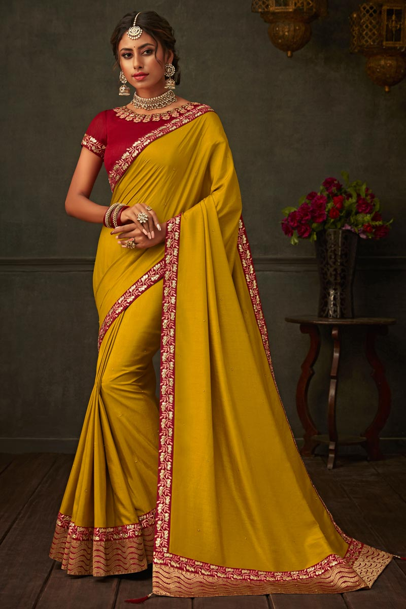 Border Work On Art Silk Fabric Designer Saree In Mustard Color With Admirable Blouse