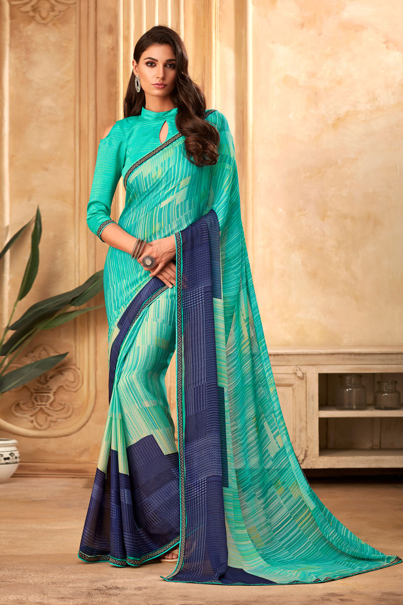 Printed Turquoise Color Fancy Saree In Georgette Fabric