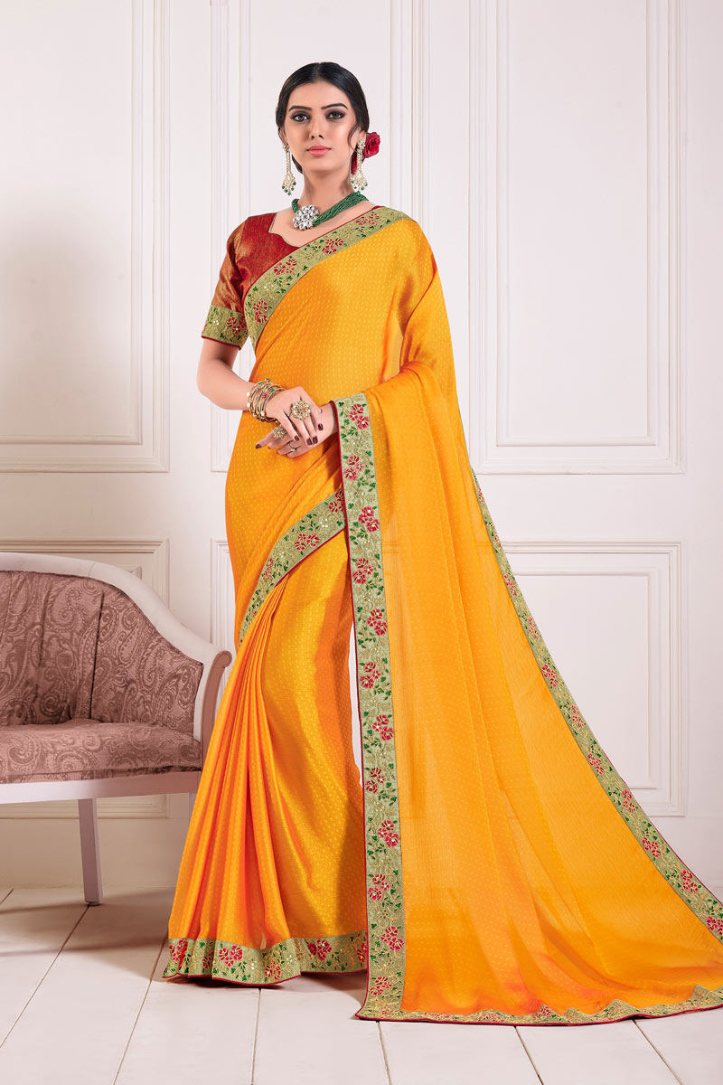 Chiffon Fabric Mustard Color Occasion Wear Saree With Lace Work And Elegant Blouse