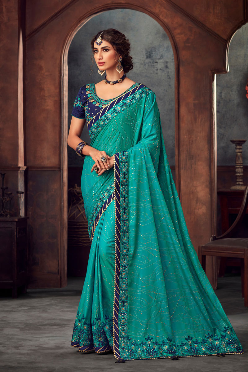 Art Silk Cyan Party Wear Saree With Embroidery Work And Charming Blouse