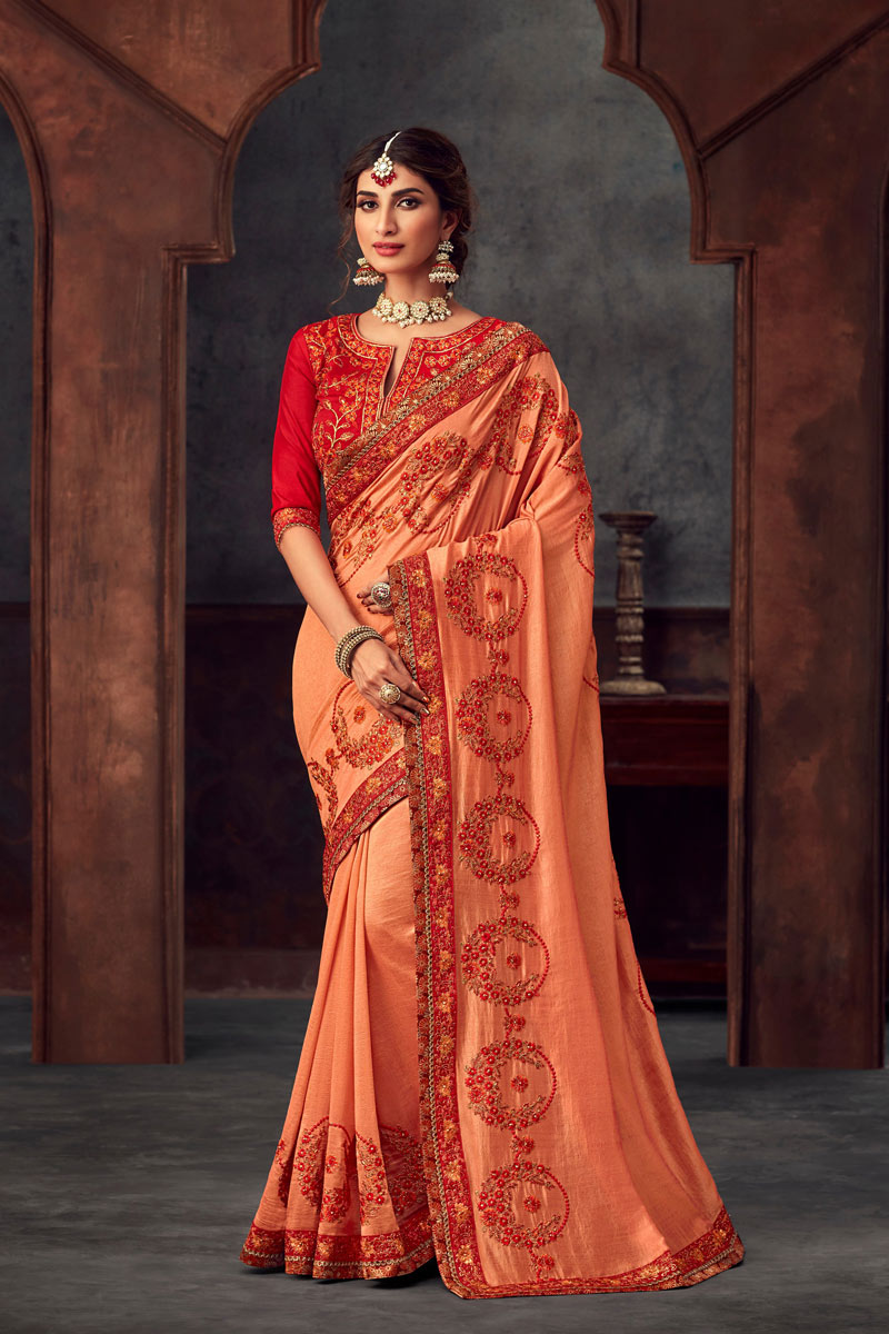 Embroidery Designs On Art Silk Occasion Wear Saree In Peach With Enticing Blouse
