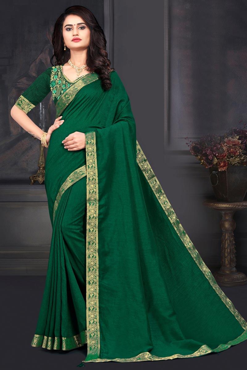 Art Silk Fabric Fancy Sangeet Wear Dark Green Color Lace Work Saree