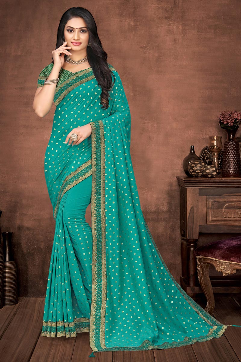 Art Silk Elegant Puja Wear Cyan Color Plain Saree With Lace Work