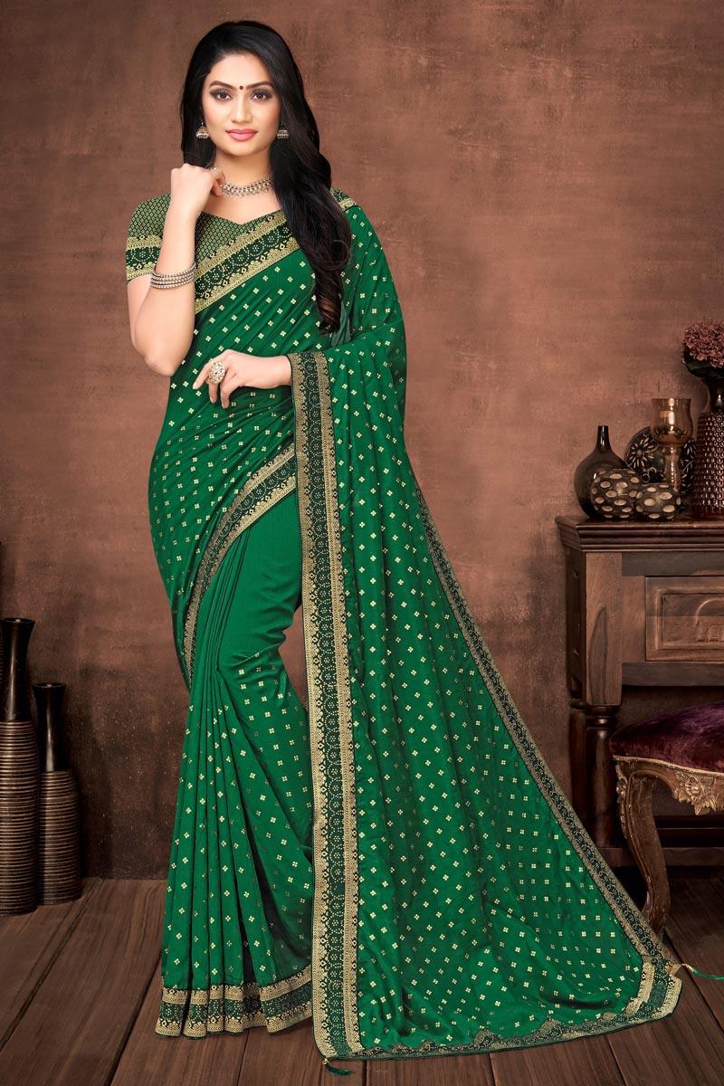 Puja Wear Elegant Green Color Art Silk Plain Saree With Lace Work