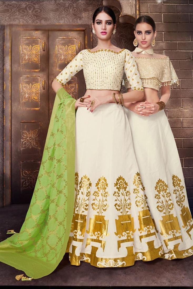 Wedding Wear Fancy Designer Off White Color Silk Fabric Embellished Lehenga