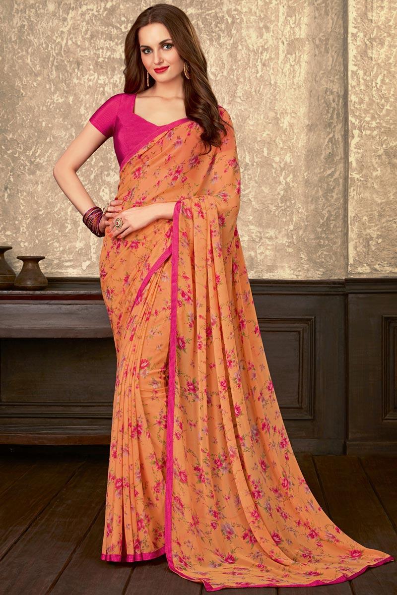 Regular Wear Fancy Orange Floral Printed Saree In Georgette Fabric