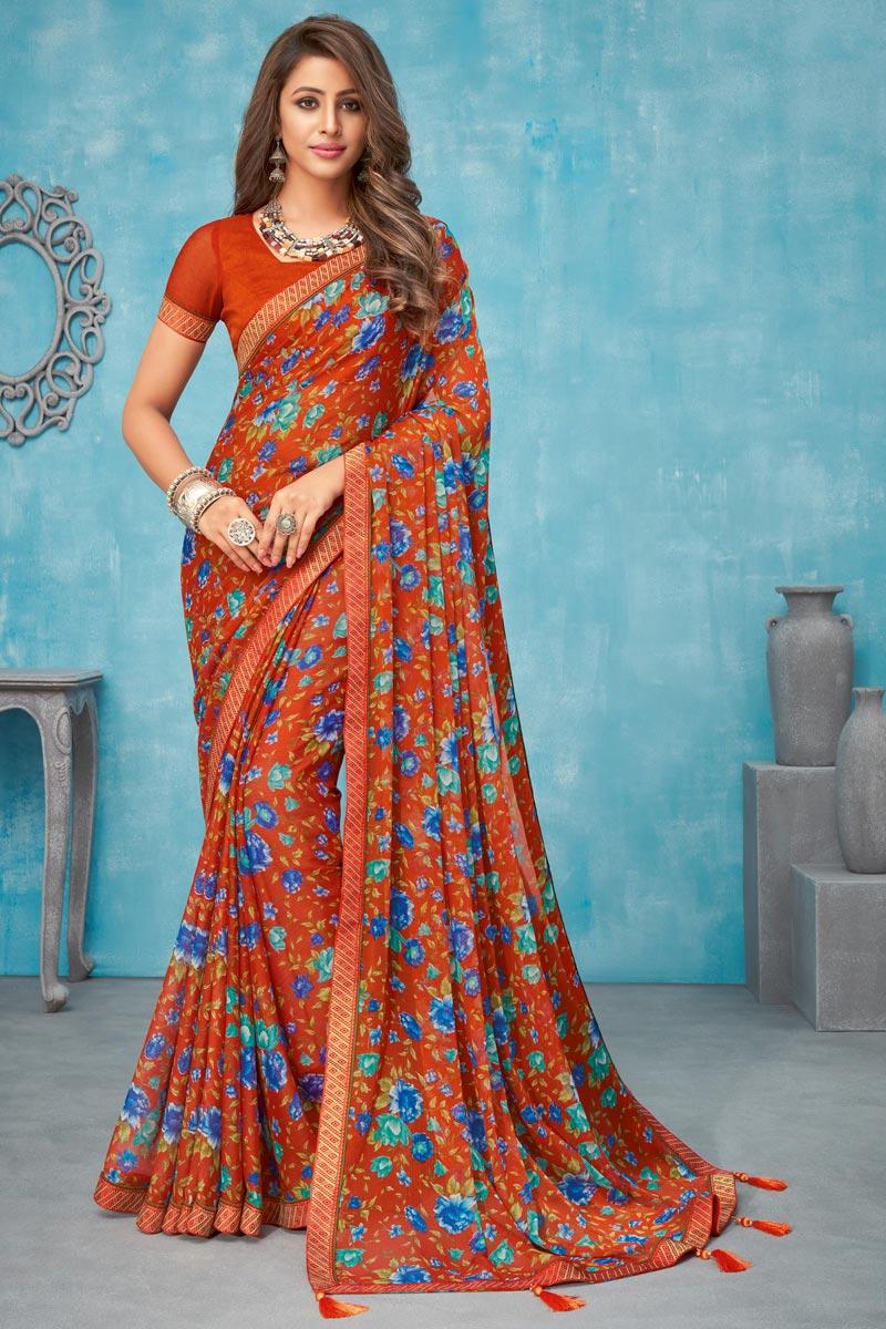 Chiffon Fabric Rust Color Regular Wear Floral Printed Saree