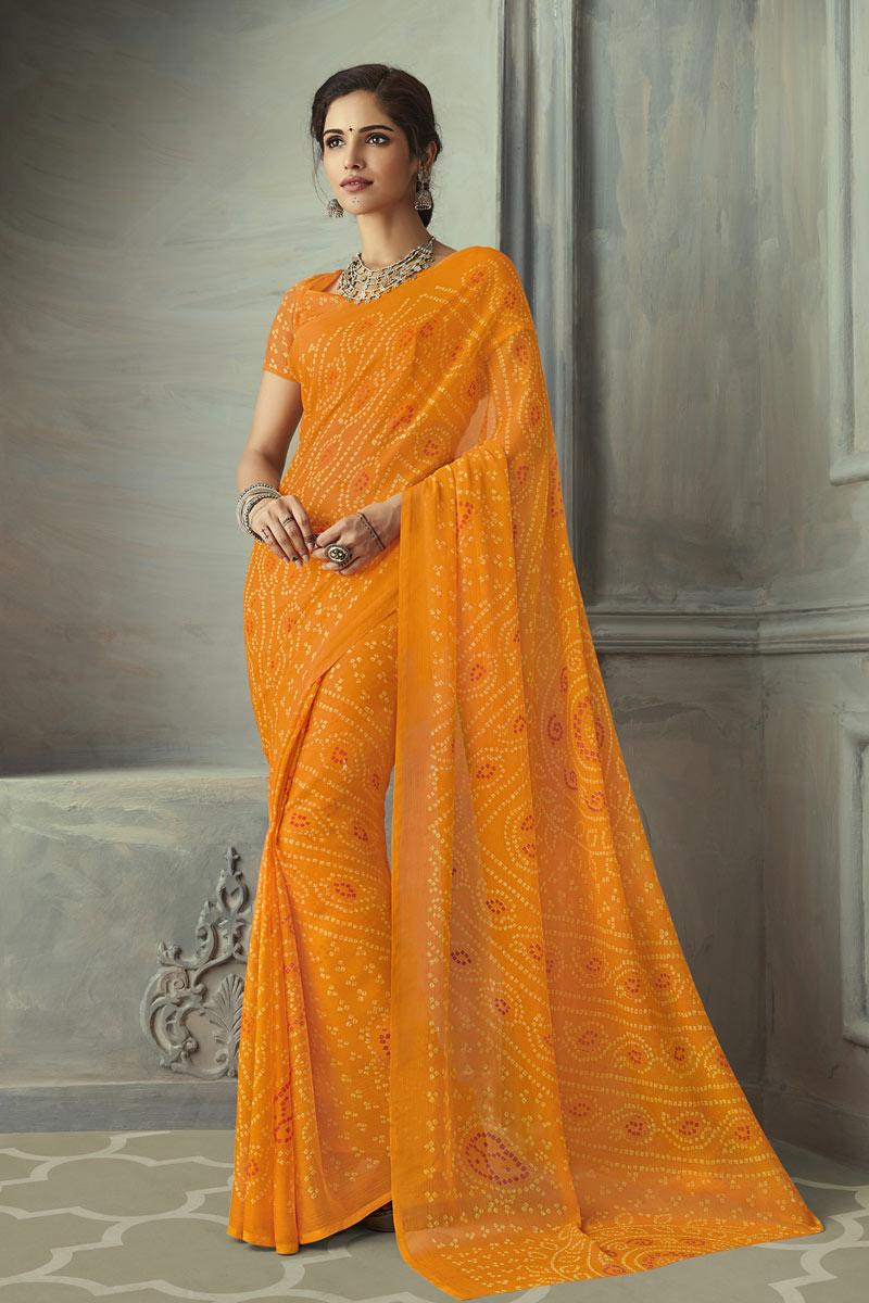 Chiffon Fabric Fancy Orange Color Bandhani Print Saree