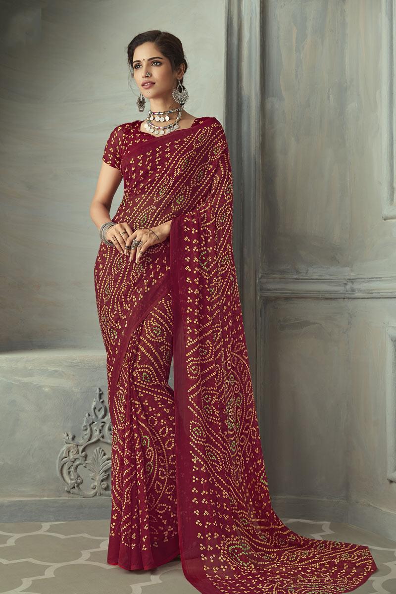 Festive Wear Fancy Bandhani Print Saree In Chiffon Fabric Maroon Color