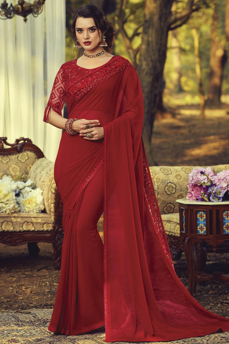Party Style Georgette Fabric Fancy Saree With Embroidered Blouse In Red Color