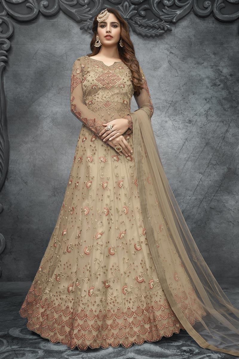 Embroidery Work Sangeet Wear Stylish Anarkali Suit In Cream Color Net Fabric