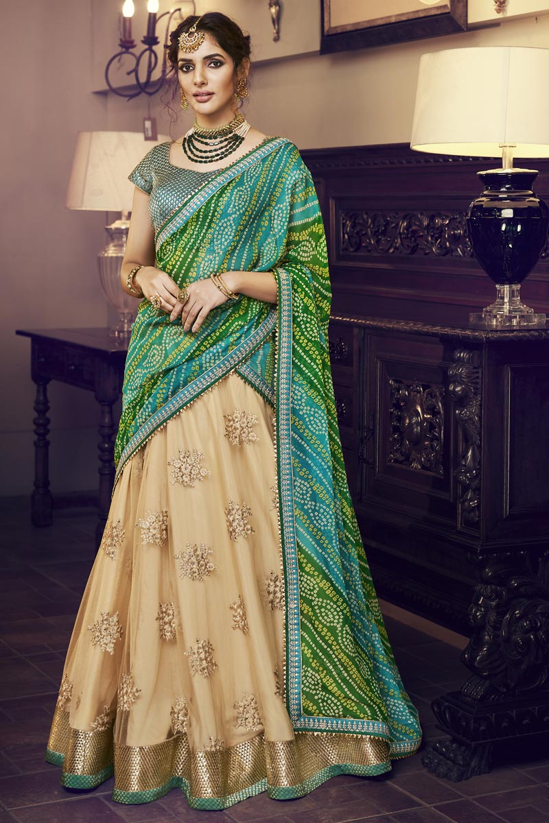 Beige Color Reception Wear Net Fabric Embroidered Designer Lehenga Choli