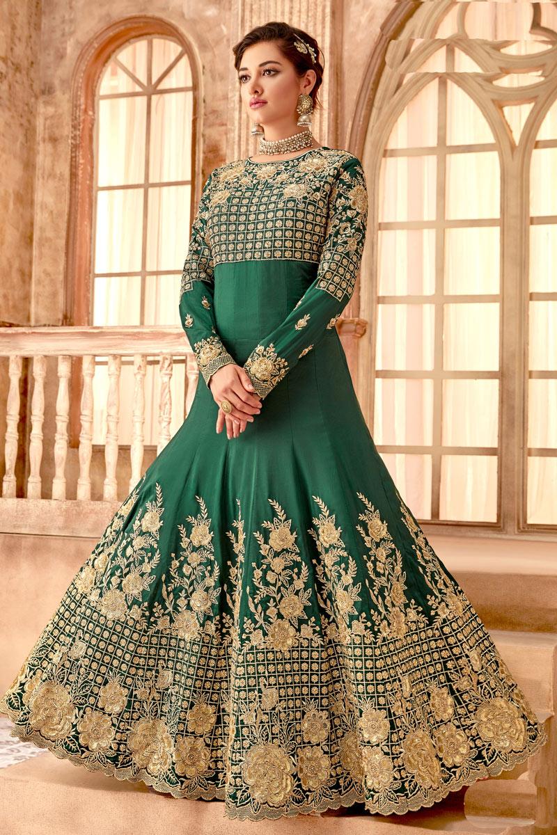 Mesmeric Fancy Fabric Embroiderd Dark Green Color Designer Anarkali Suit