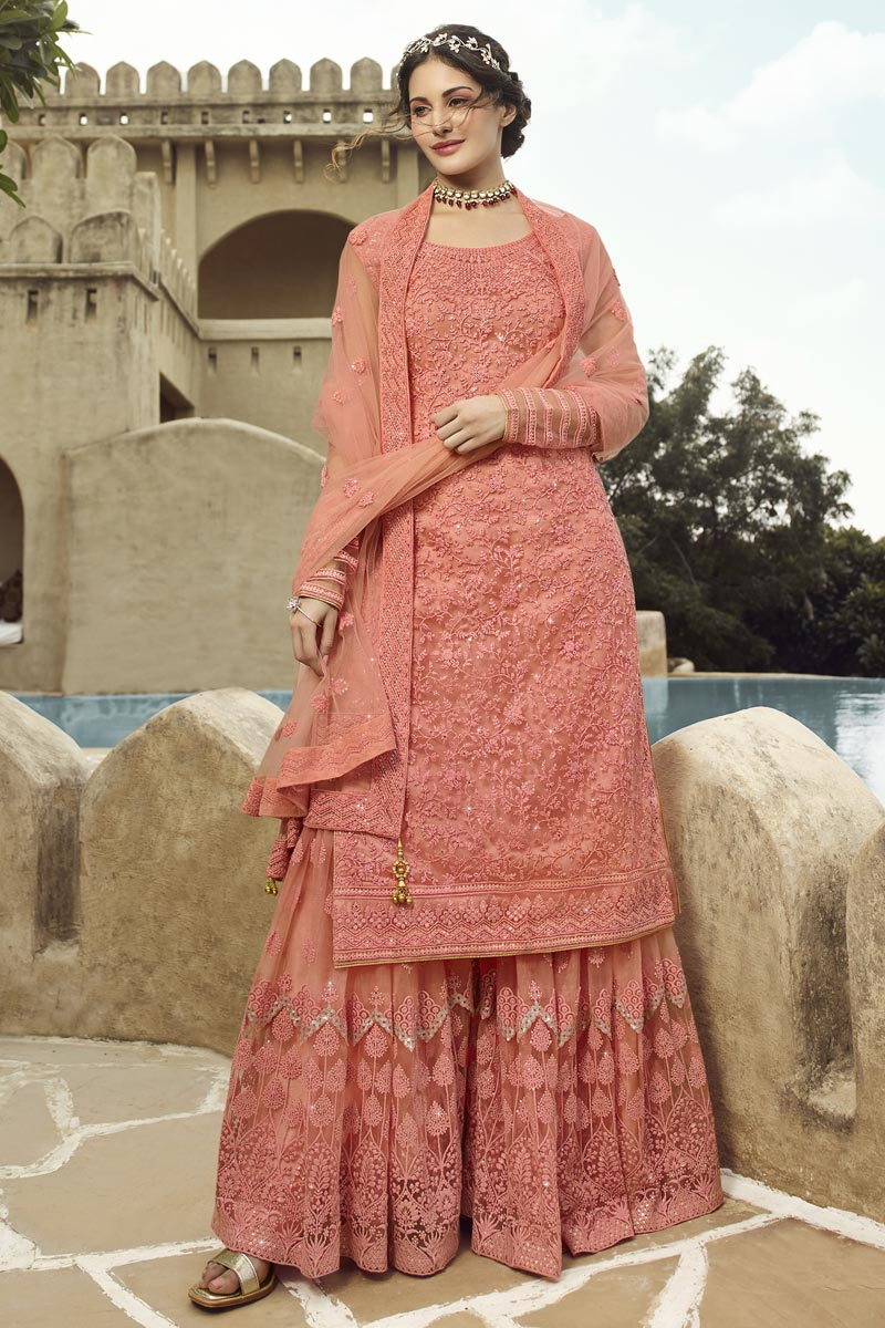 Festive Special Occasion Wear Salmon Color Embroidered Sharara Style Palazzo Salwar Kameez In Net Fabric