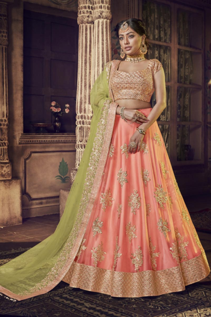 Traditional Net Fabric Embroidered Lehenga Choli In Peach Color