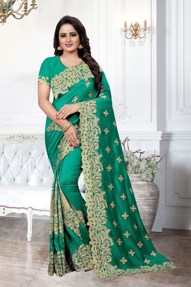 Art Silk Fabric Teal Party Wear Saree With Embroidery Work And Charming Blouse