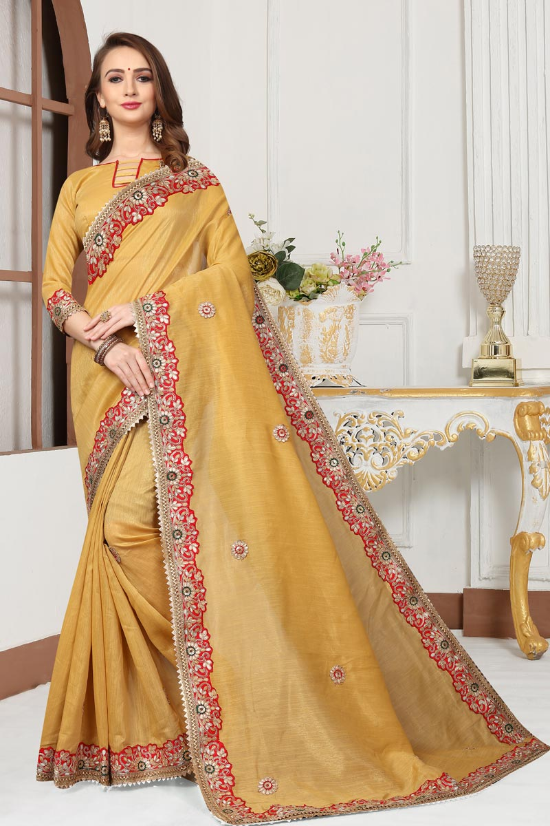 Cotton Silk Fabric Golden Color Occasion Wear Saree With Embroidery Work And Designer Blouse