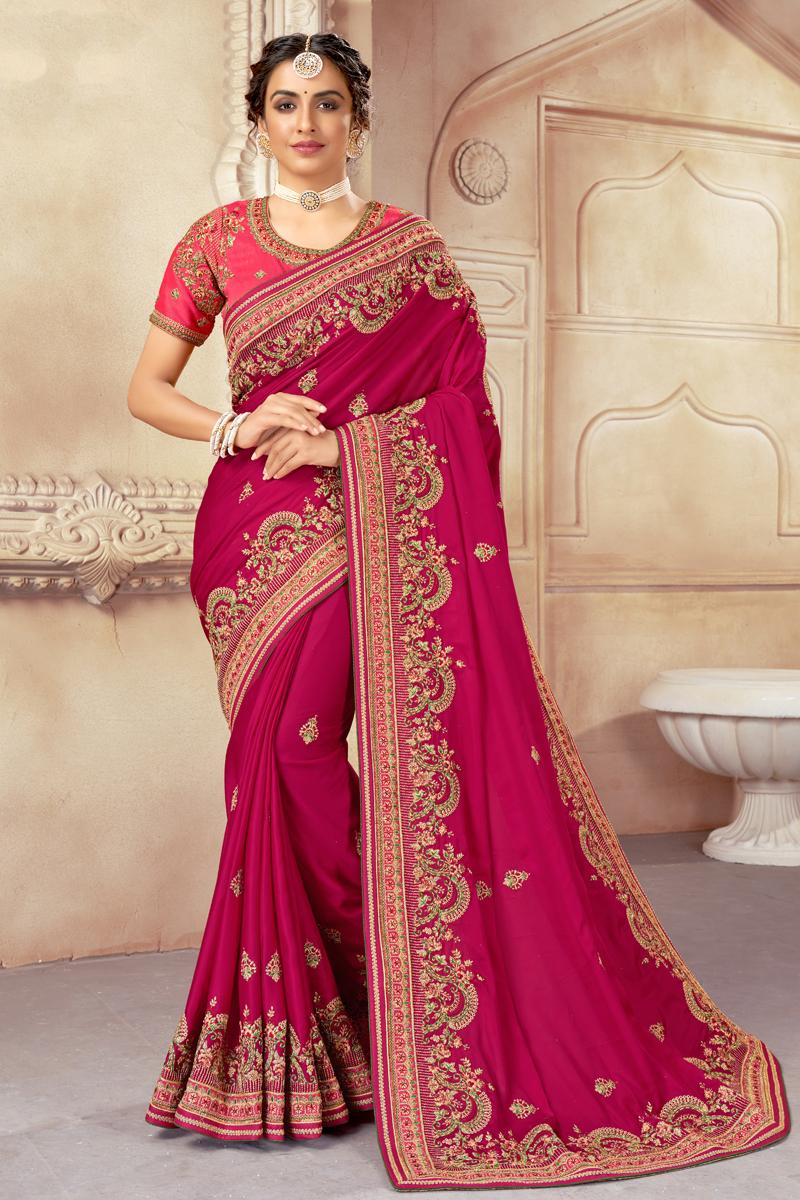 Art Silk Fabric Embroidered Rani Color Wedding Wear Fancy Saree