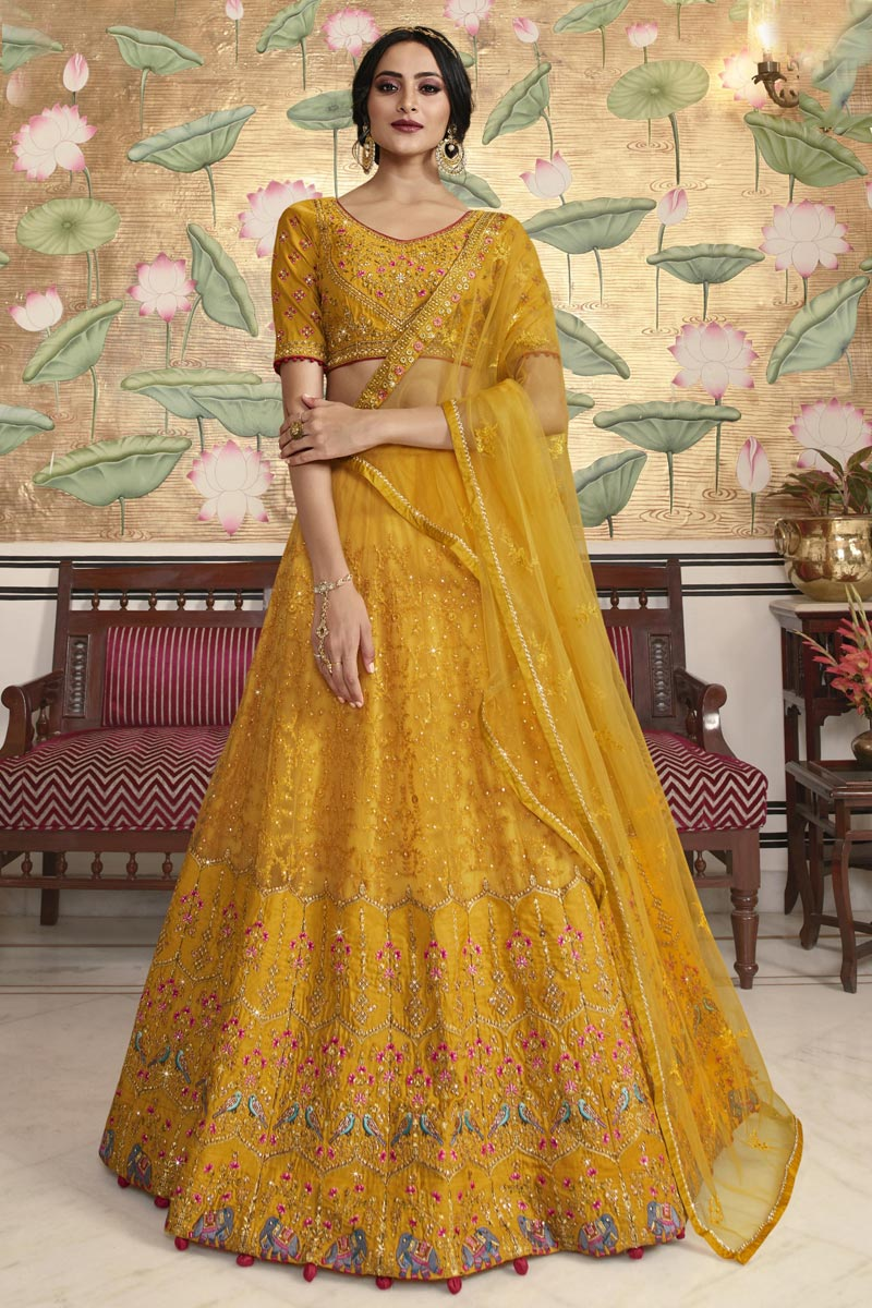 Eid Special Mustard Function Wear Traditional Embroidered Lehenga In Net Fabric