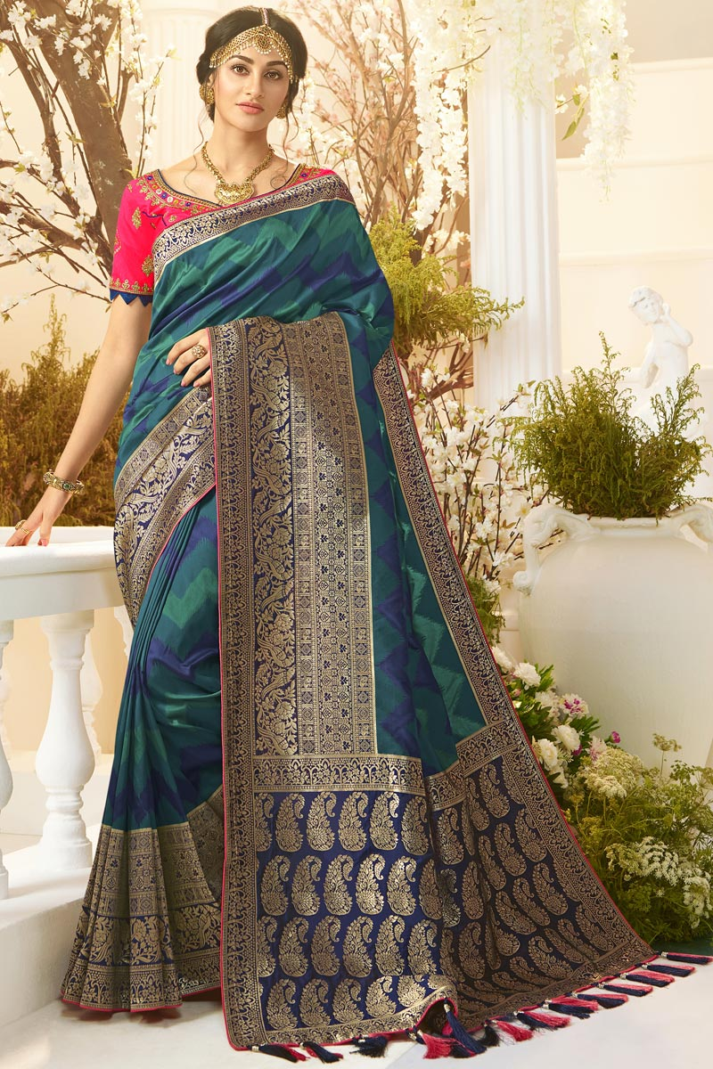 Jacquard And Silk Fabric Traditional Wear Designer Saree With Embroidered Blouse In Teal Color