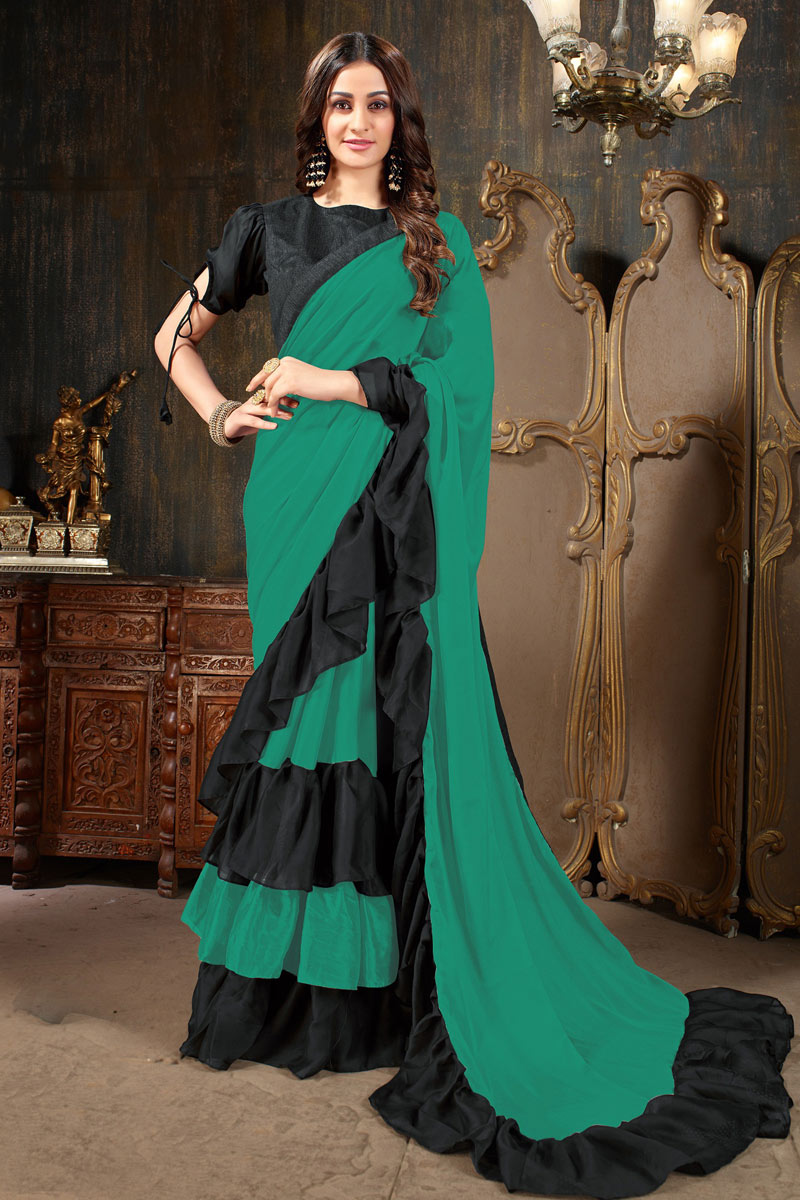 Mesmeric Georgette Fabric Teal Party Wear Saree