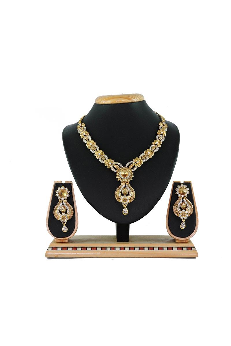 Designer Fancy Alloy Metal Golden Artificial Necklace Set