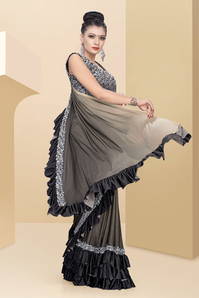 Fancy Work On Lycra Fabric Party Wear Ruffle Border Saree In Dark Beige Color With Beautiful Blouse