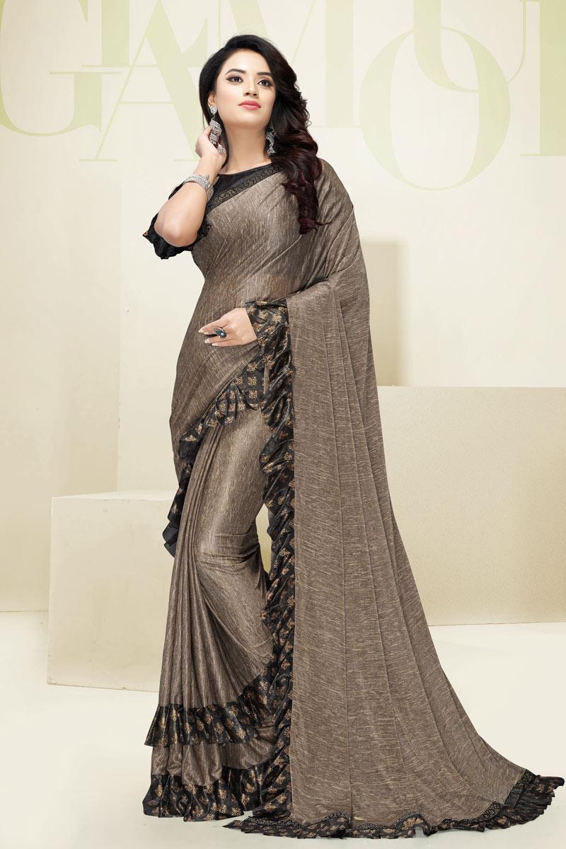 Ruffle Border On Fancy Fabric Designer Saree In Dark Beige With Attractive Blouse