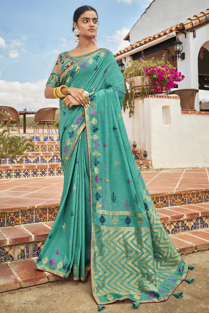 Jacquard Silk Fabric Trendy Cyan Color Puja Wear Weaving Work Saree