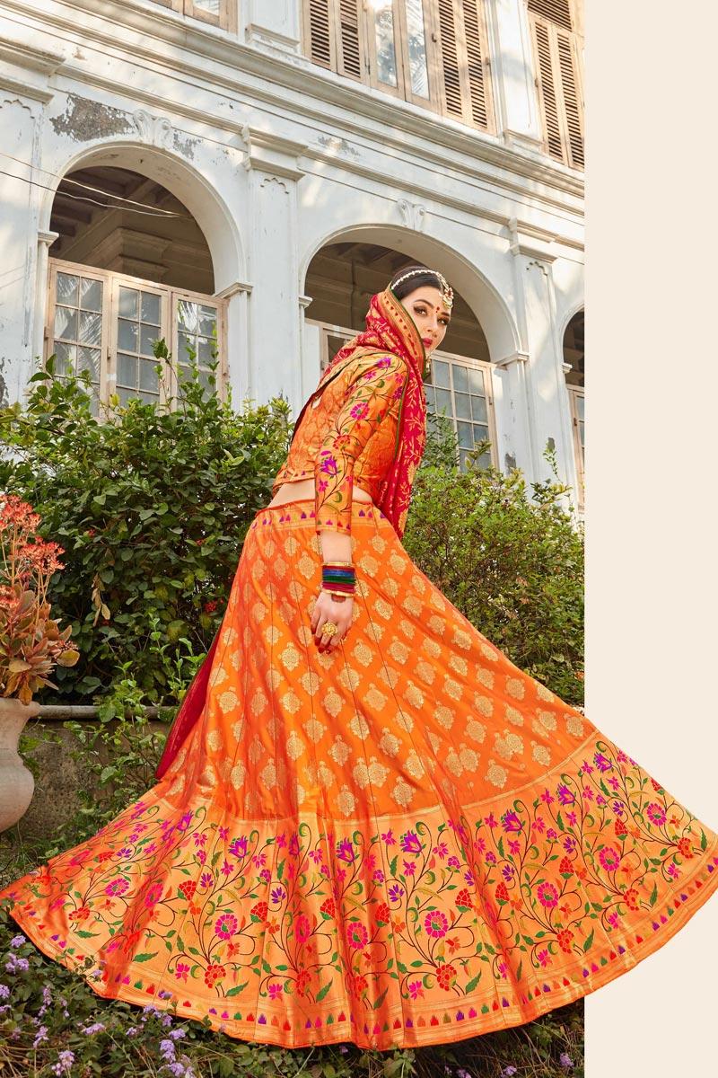Banarasi Style Silk Fabric Function Wear Weaving Work Lehenga Choli In Orange Color