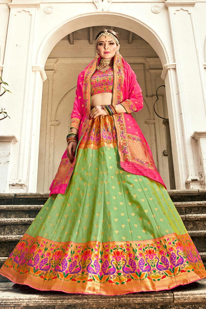 Trendy Sea Green Color Sangeet Function Wear Banarasi Style Silk Fabric Weaving Work Lehenga