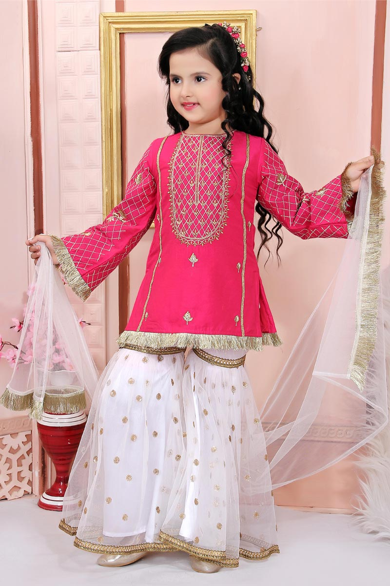 Girls Wear Party Style Rani Color Sharara Suit In Cotton Silk Fabric