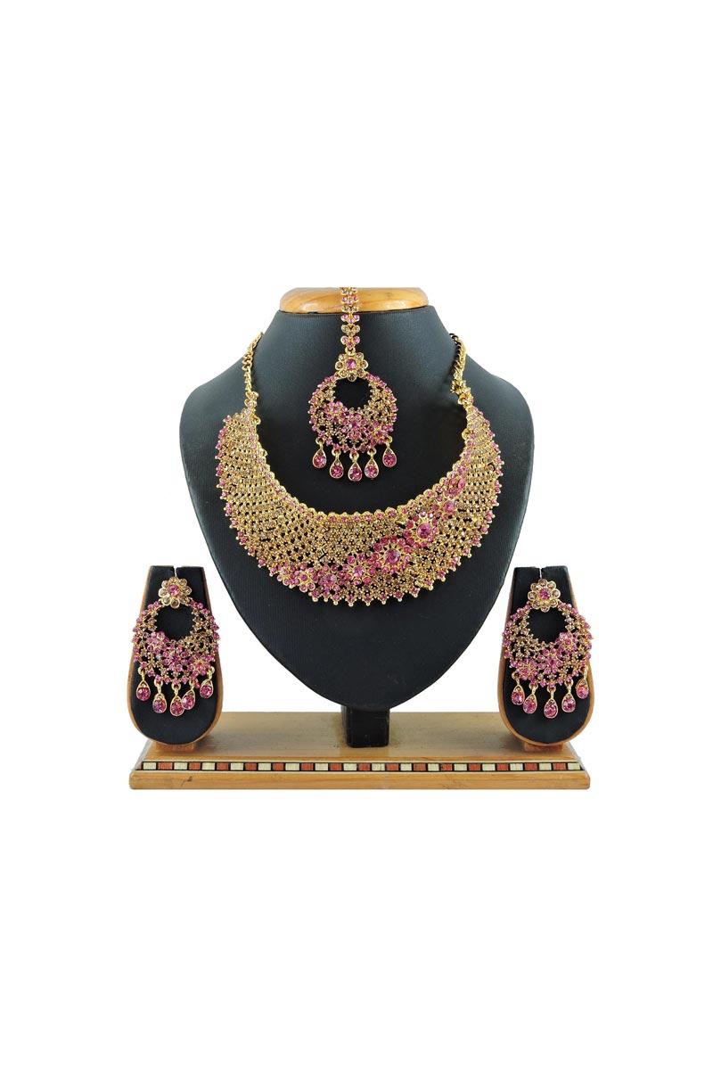 Beguiling Bridal Wear Pink Color Alloy Metal Necklace Set