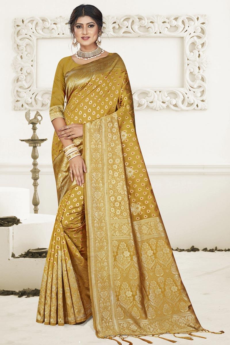 Mustard Puja Wear Art Silk Fabric Fancy Weaving Work Saree