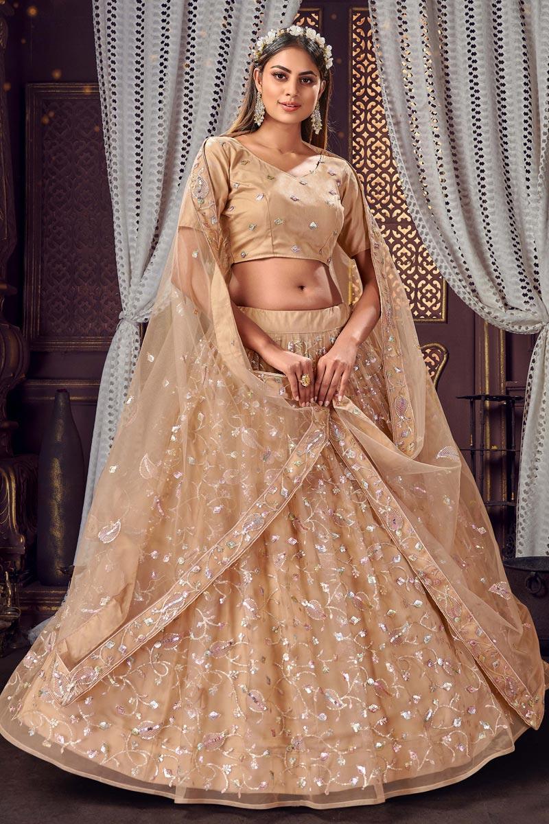 Net Fabric Sequins Work Festive Wear Trendy Lehenga Choli In Chikoo Color