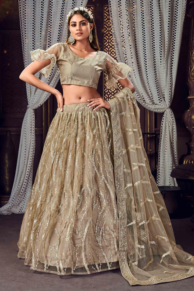 Cream Color Net Fabric Sequins Work Reception Wear Fancy Lehenga Choli