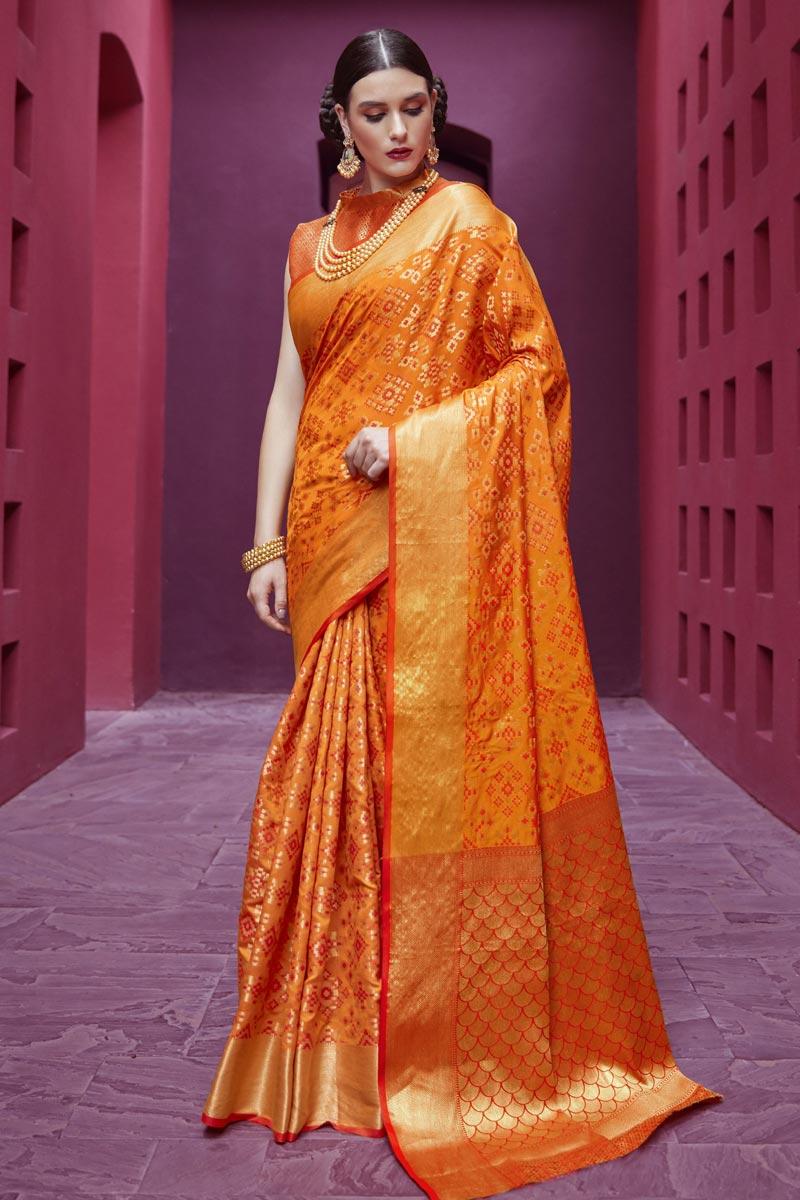 Fancy Festive Wear Orange Patola Style Weaving Work Saree In Art Silk Fabric