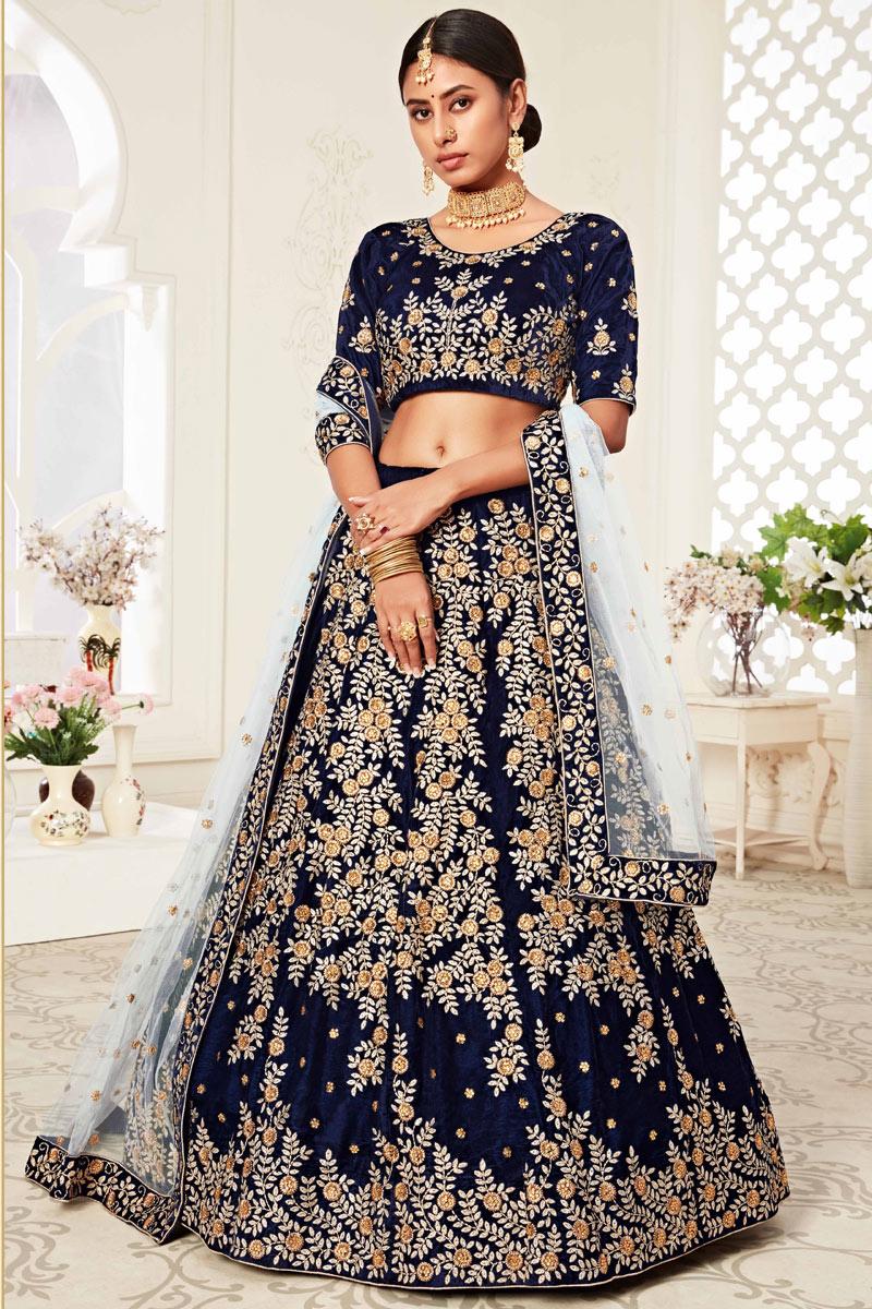 Sangeet Wear Embroidered Fancy Lehenga Choli In Navy Blue Color Velvet Fabric