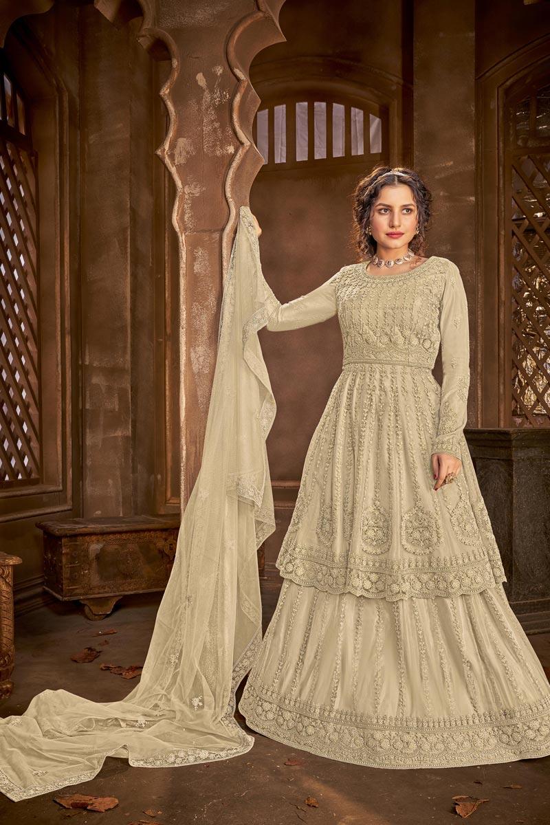 Festive Wear Net Fabric Chic Embroidered Sharara Top Lehenga In Cream Color