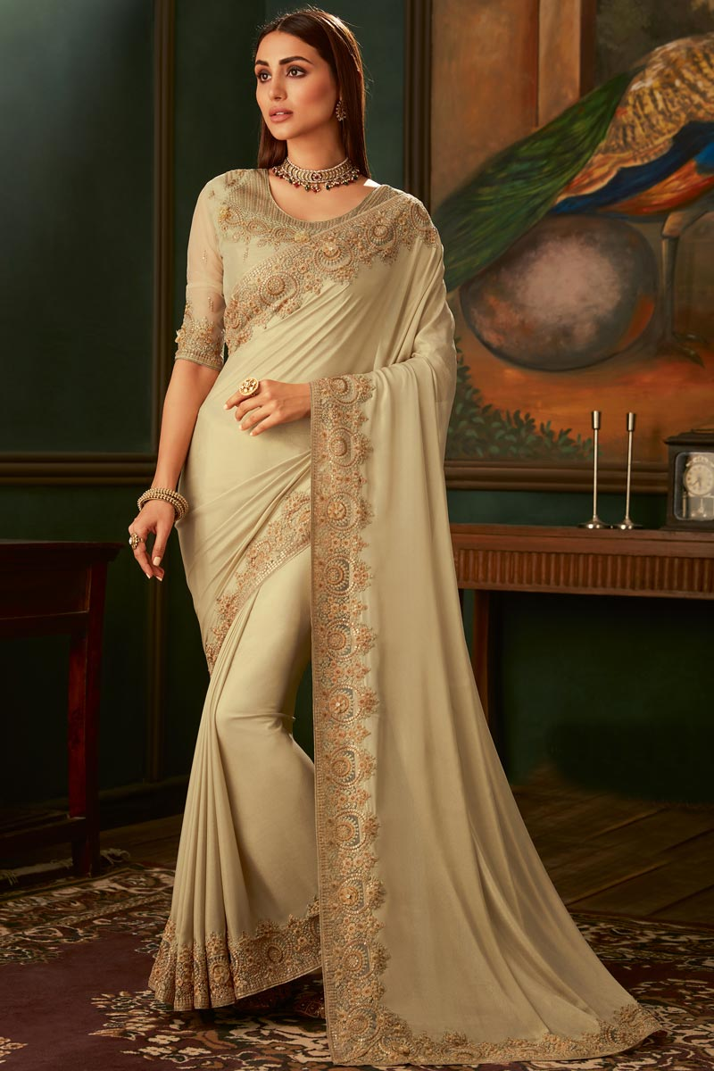 Eid Special Georgette Fabric Cream Color Function Wear Designer Border Work Saree With Heavy Blouse